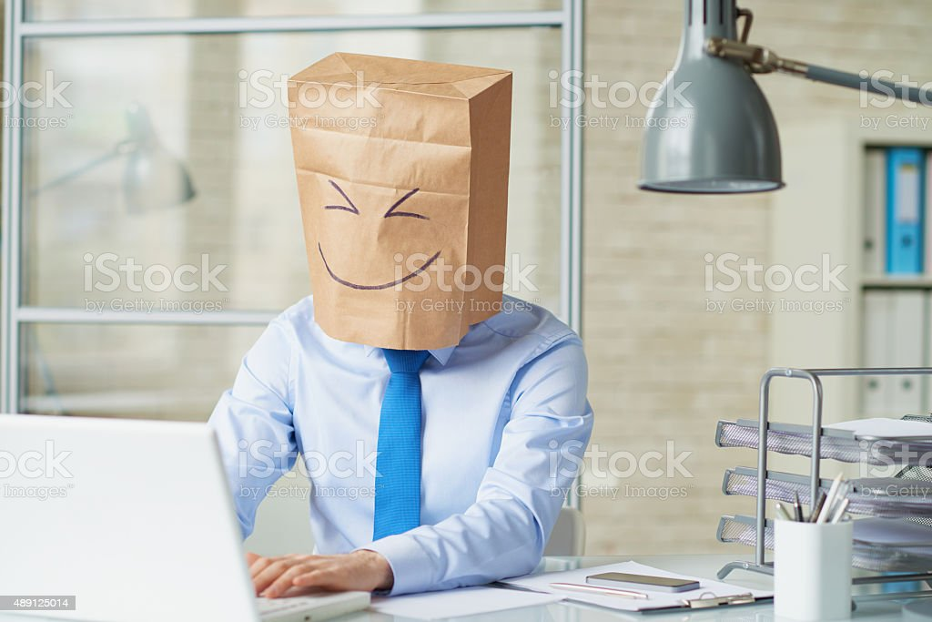 Paper bag on head stock photo