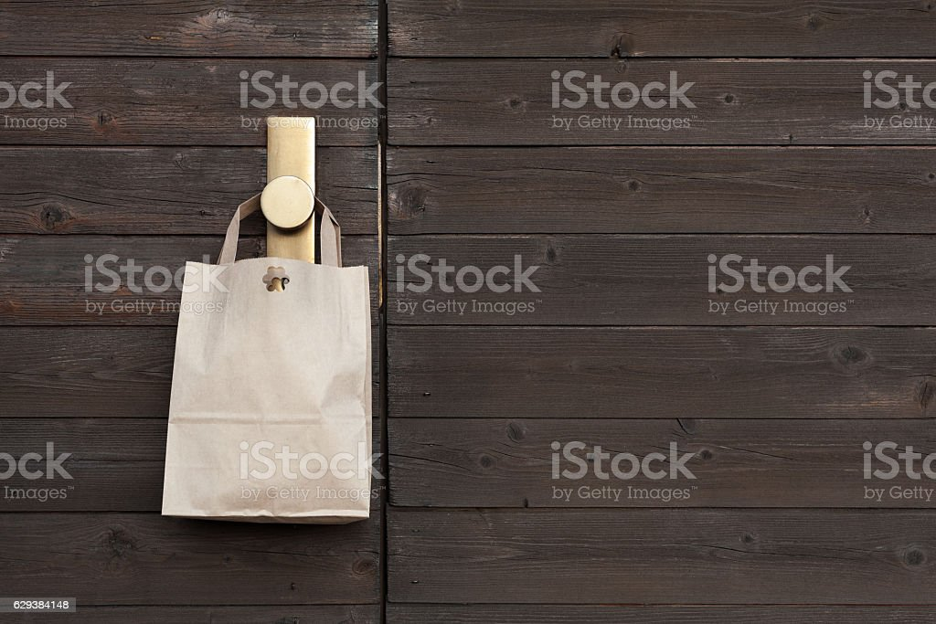 Paper bag on wooden background stock photo