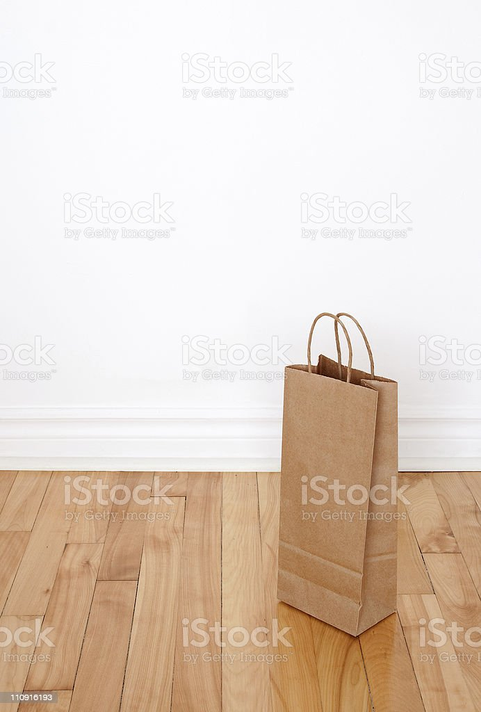 Paper bag on wooden floor royalty-free stock photo