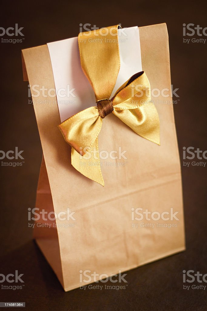 Paper bag present with a bow royalty-free stock photo