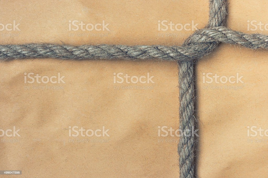Paper bag tied with a rope stock photo