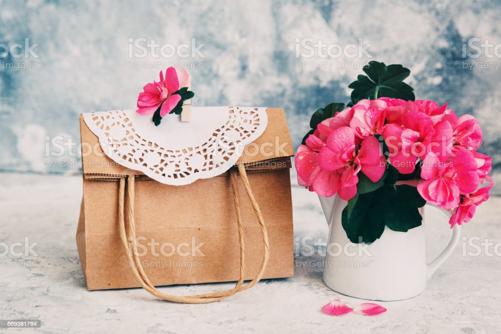Paper bag with flowers stock photo