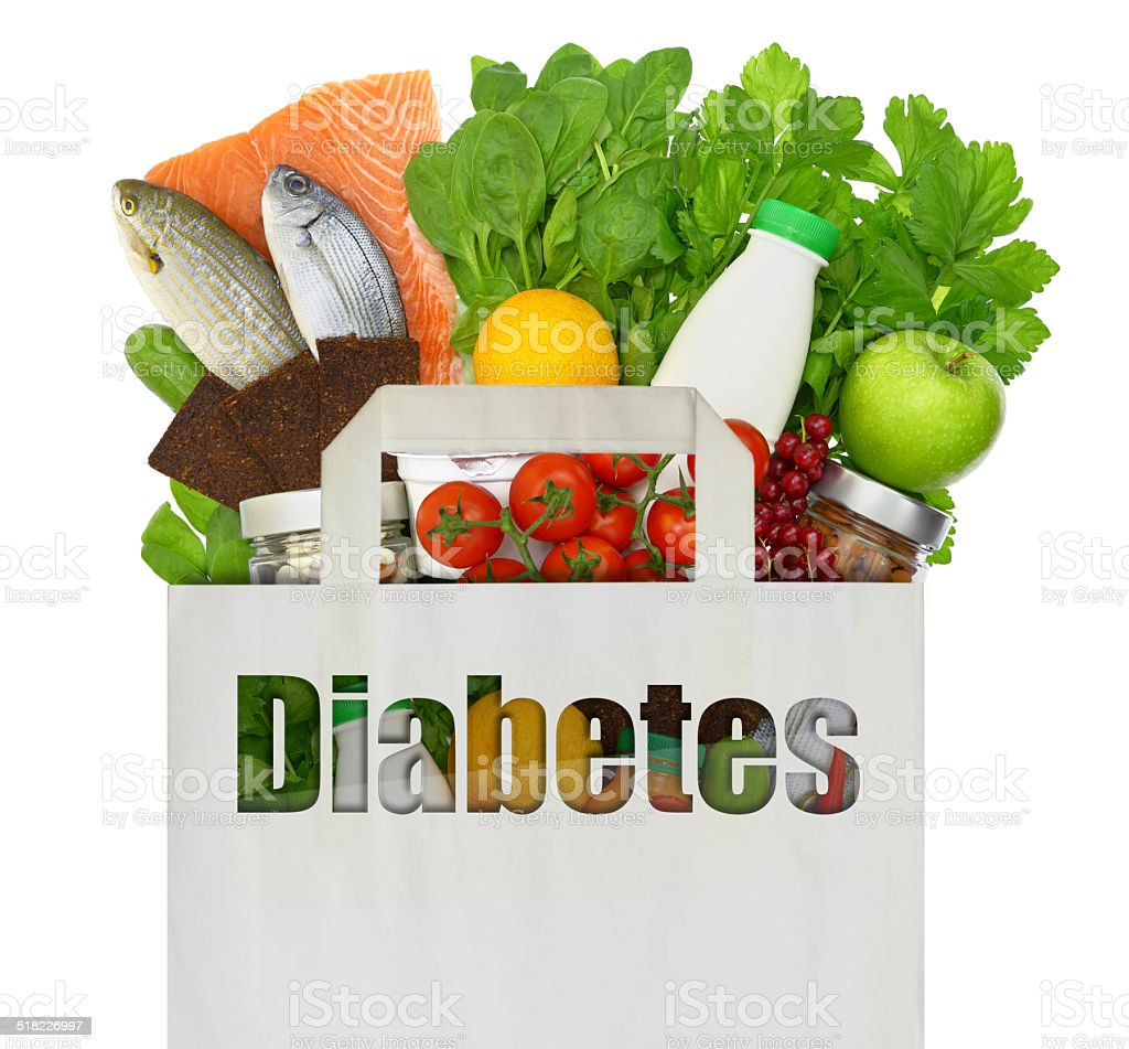 Paper bag with the word diabetes filled with healthy foods stock photo