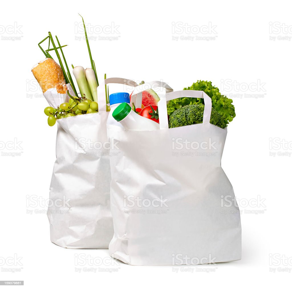Paper bags packed with food on white stock photo