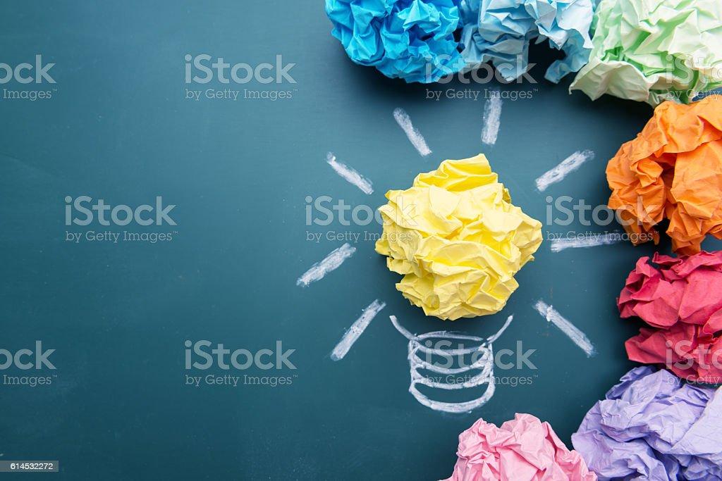 Paper Ball on Blackboard and Lightbulb Shape stock photo