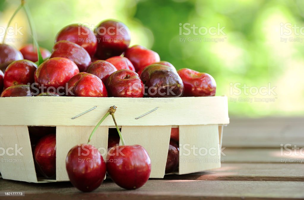 Paper basket filled with cherries stock photo