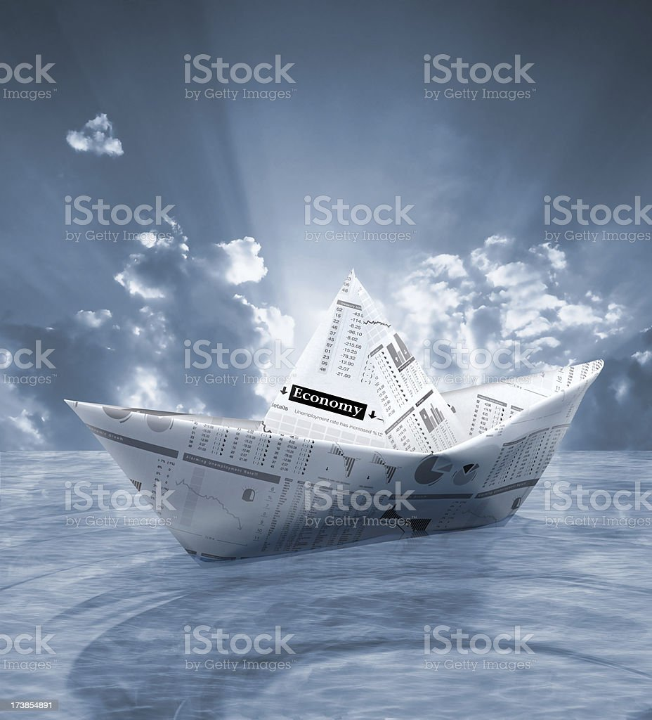 Paper boat made from finance newspaper royalty-free stock photo