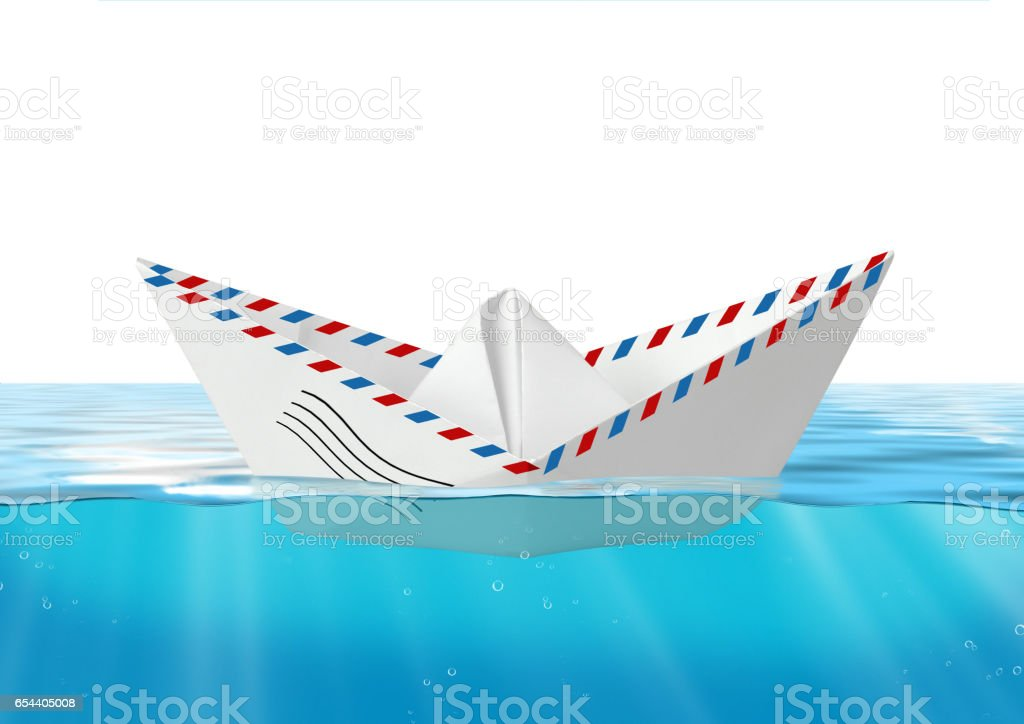 Paper boat made from mail envelope floating at water, post concept stock photo