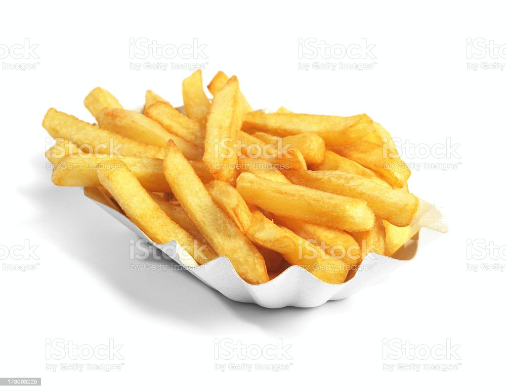 Paper boat of golden French fries on white background stock photo