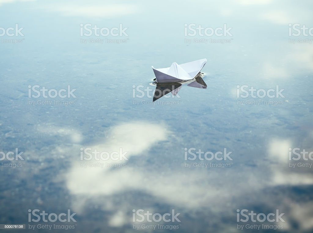 paper boat on grand adventure stock photo