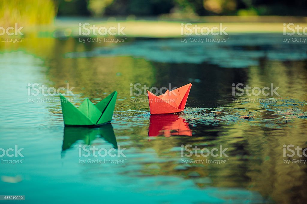 Paper boat on the river freedom wave stock photo