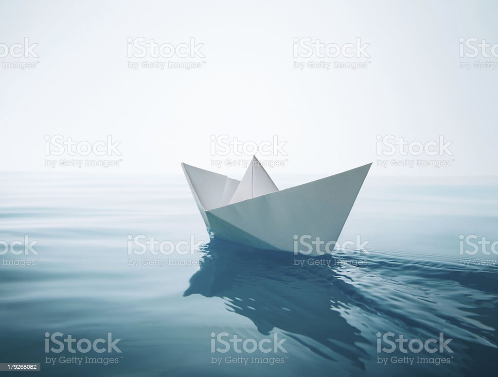 paper boat sailing stock photo