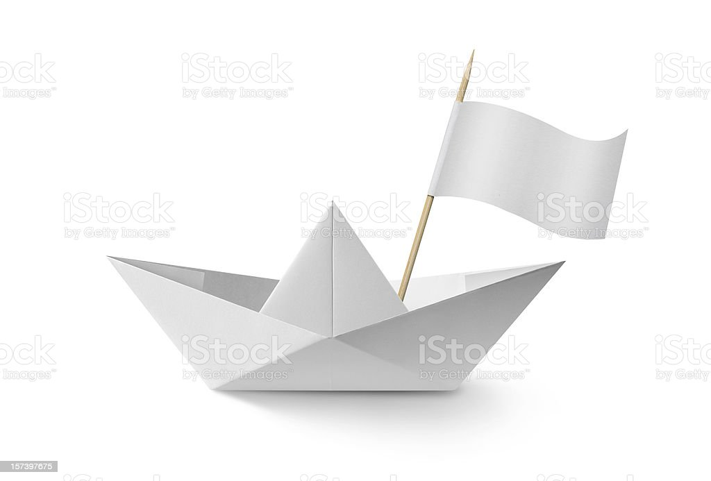 Paper boat with flag stock photo