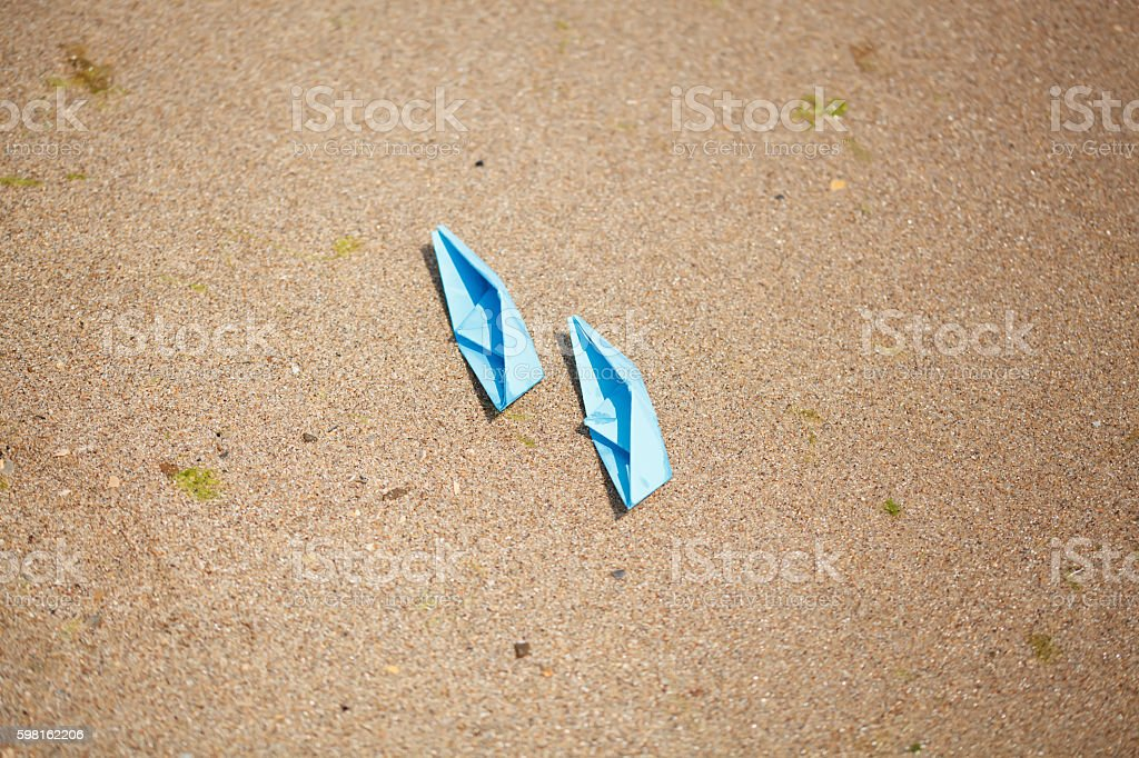 Paper Boat with shells and sand. Vocation and travel background stock photo