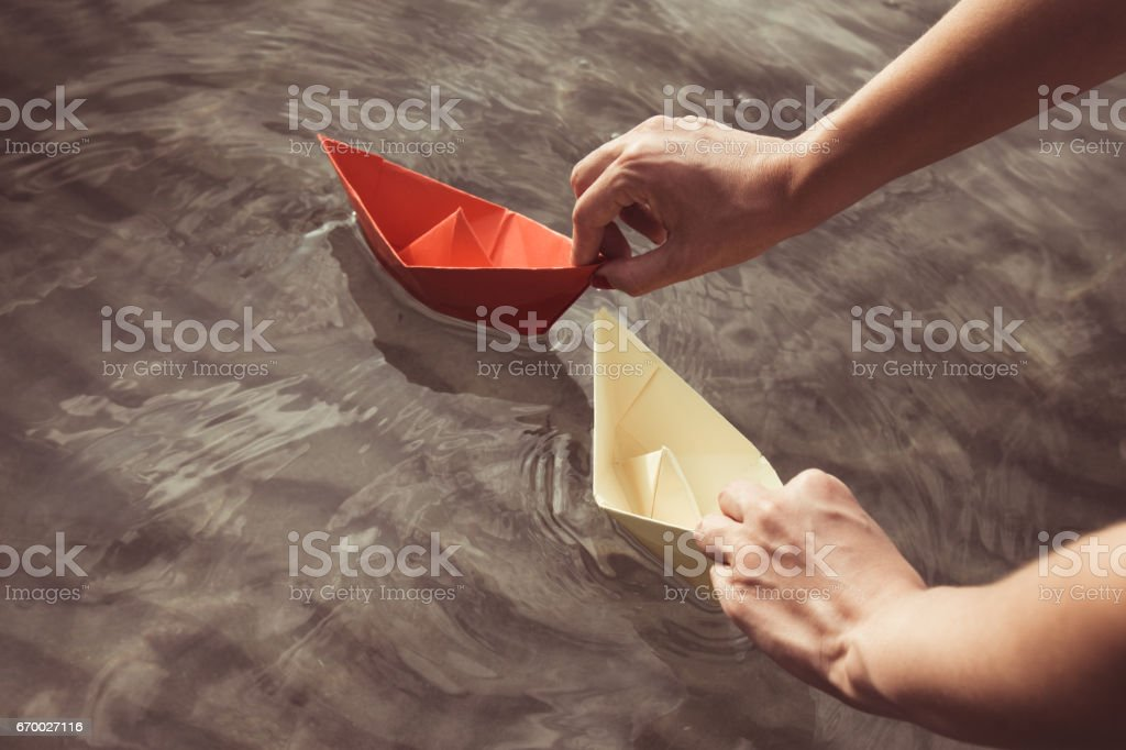 Female floating paper boats