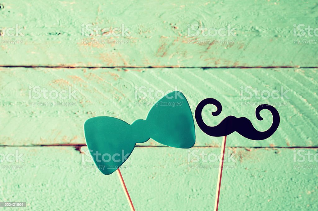 paper bow and mustache in sticks stock photo