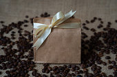 Paper box with coffee beans  and bow