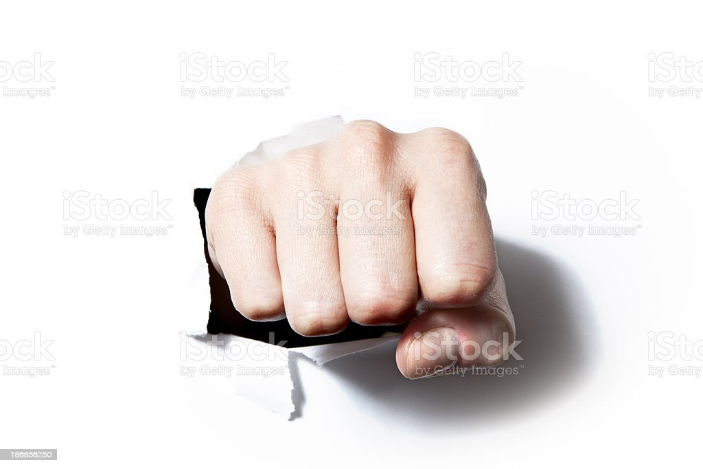 Paper broken by the fist stock photo
