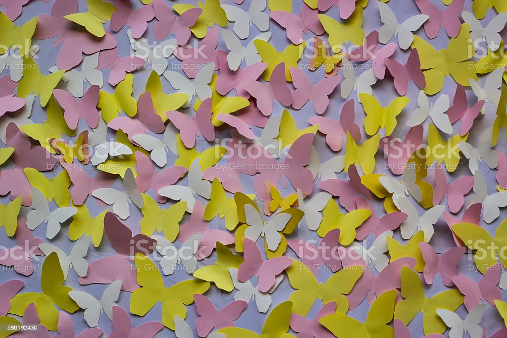 paper butterflies on the wall stock photo