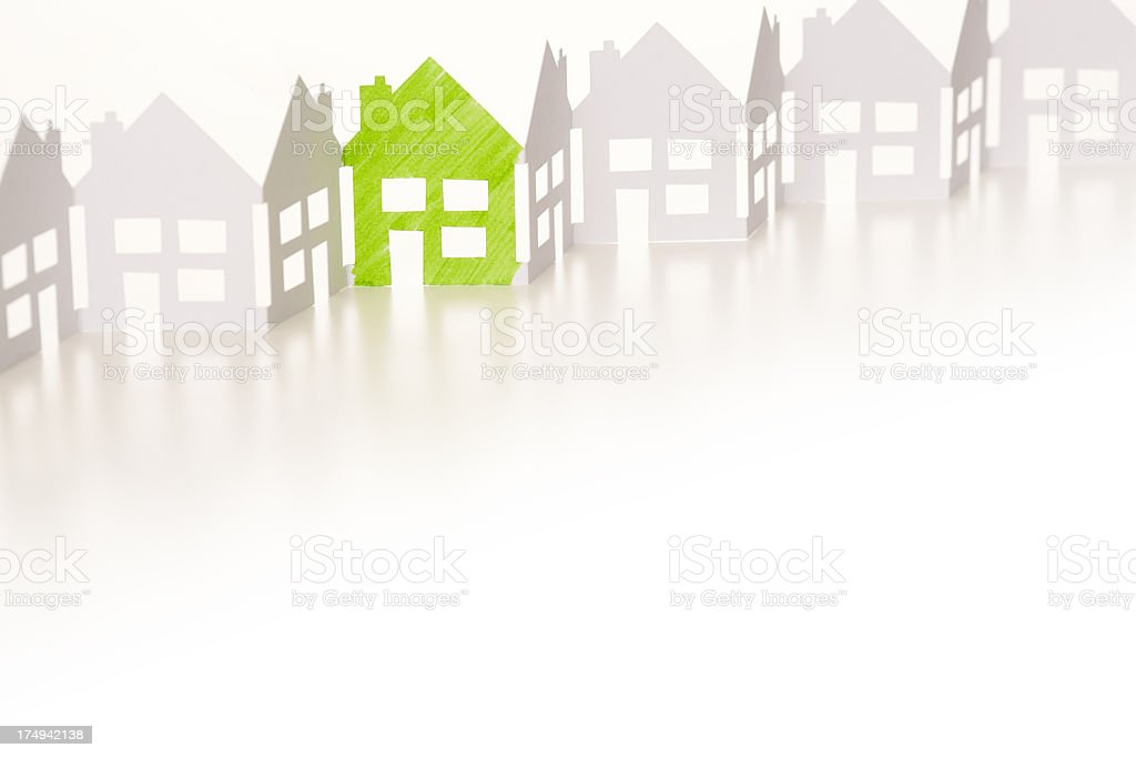 Paper chain houses one coloured green royalty-free stock photo