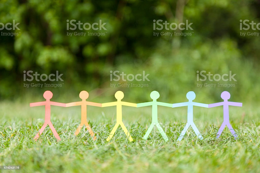 Paper Chain Illustration of People Holding Hands stock photo