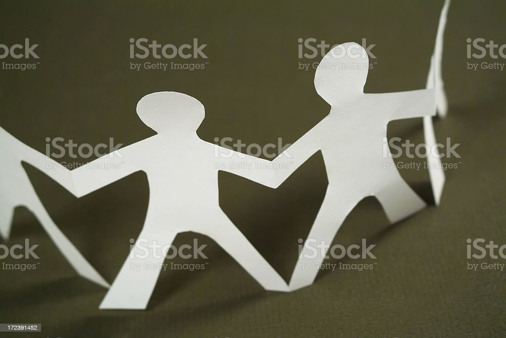 Paper chain in shape of kids stock photo