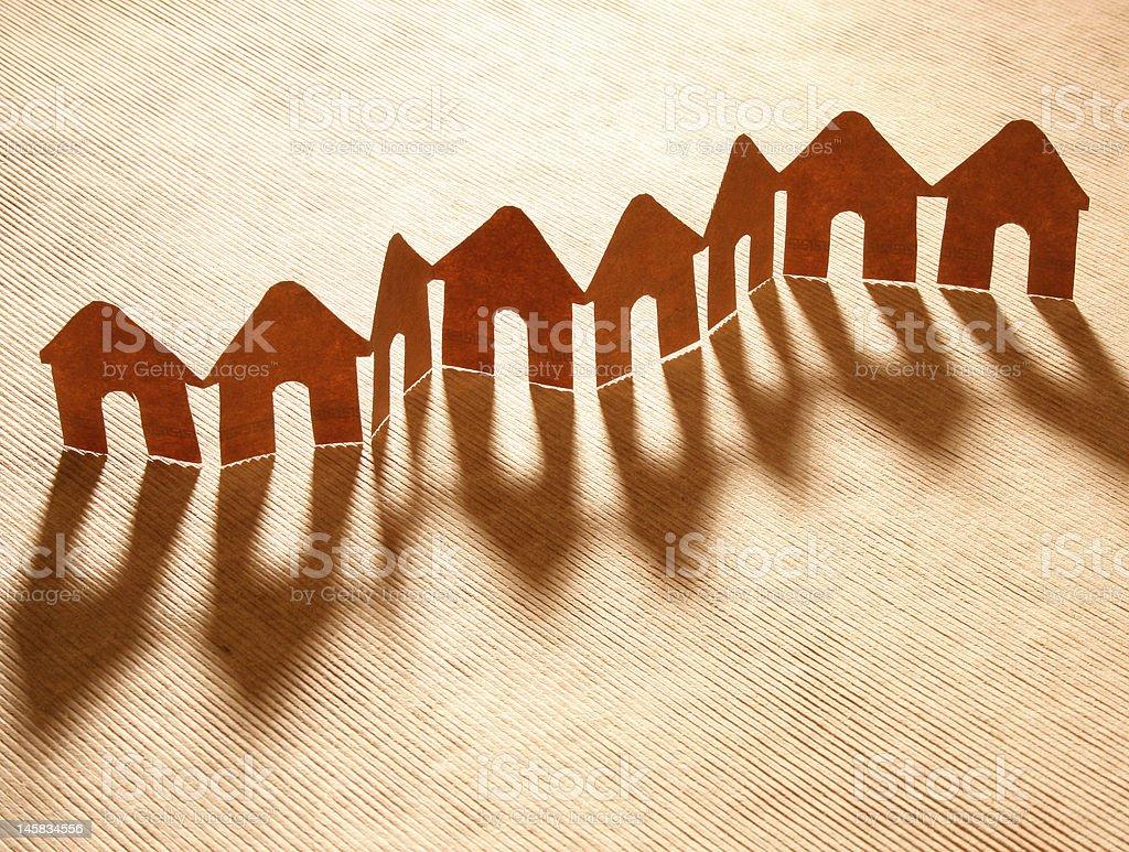 A paper chain of multiple houses making up a neighborhood royalty-free stock photo