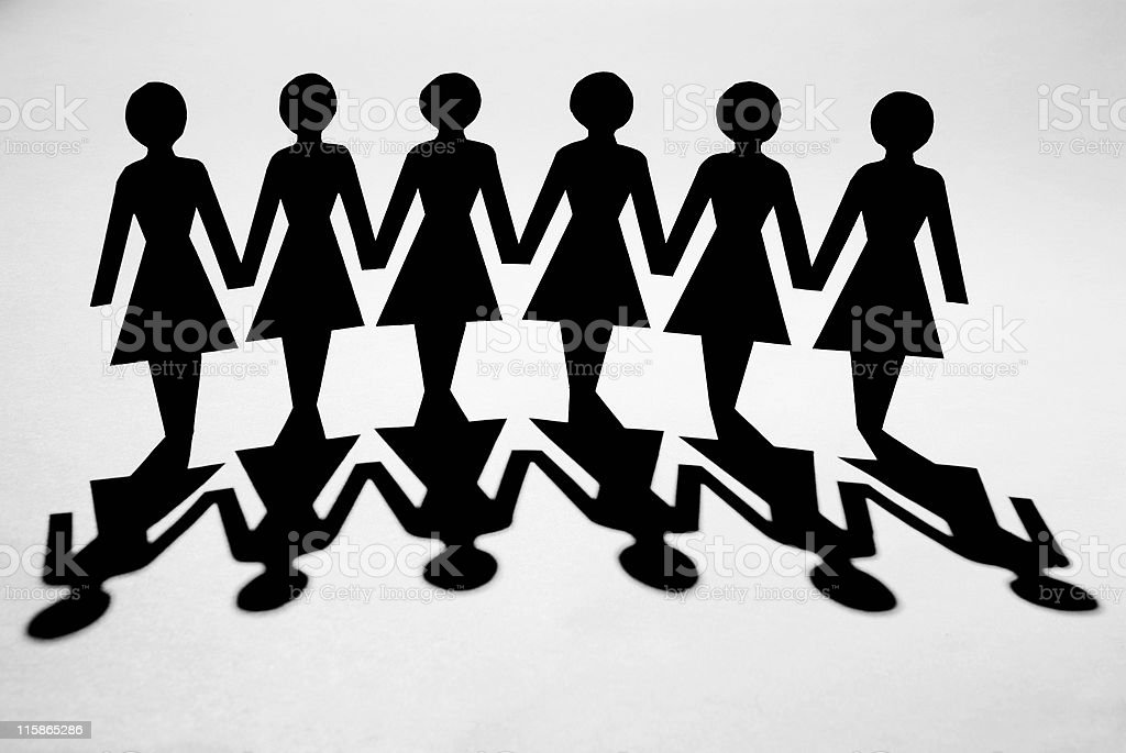 Paper chain of women with shadow royalty-free stock photo