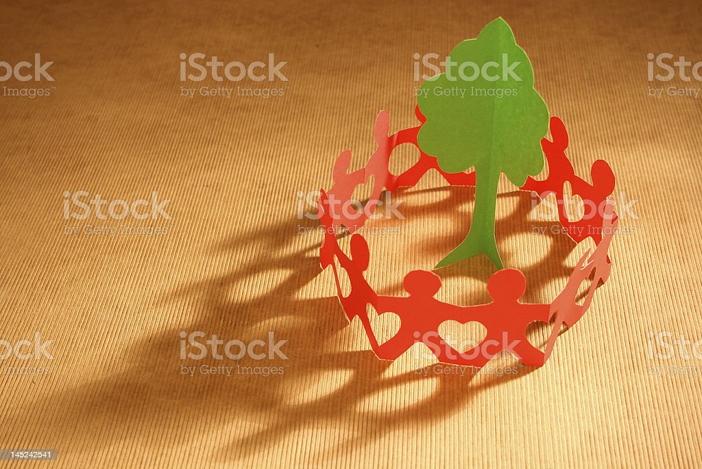 Paper chain people caring for the planet royalty-free stock photo
