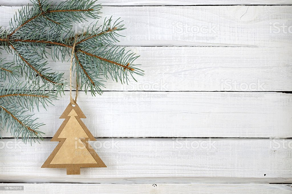 Paper Christmas tree and branches of blue spruce royalty-free stock photo