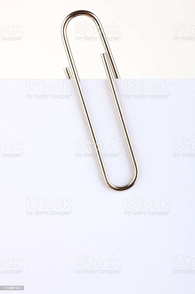 Paper clip holding a blank stock photo