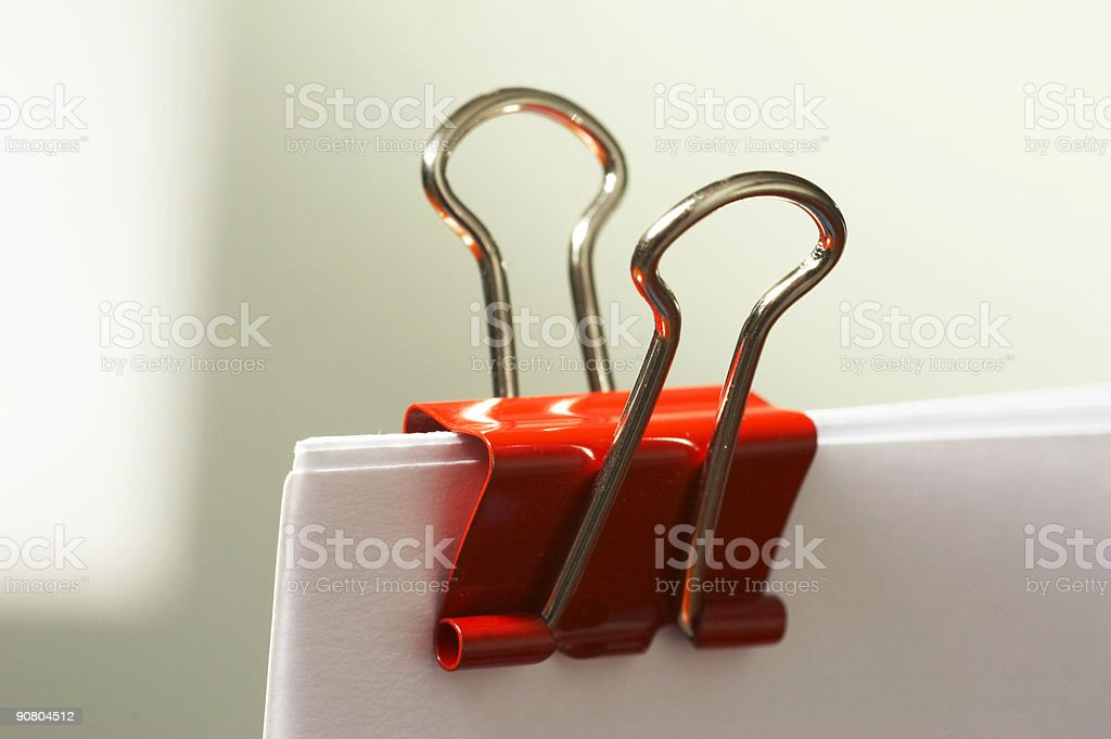paper clip in red stock photo