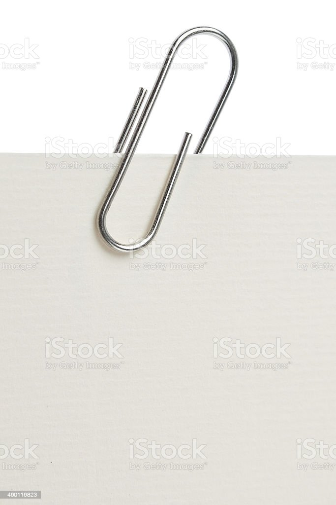 Paper clip on a piece of paper. Close-up. stock photo