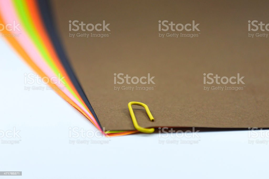 paper clip with colorful papers stock photo