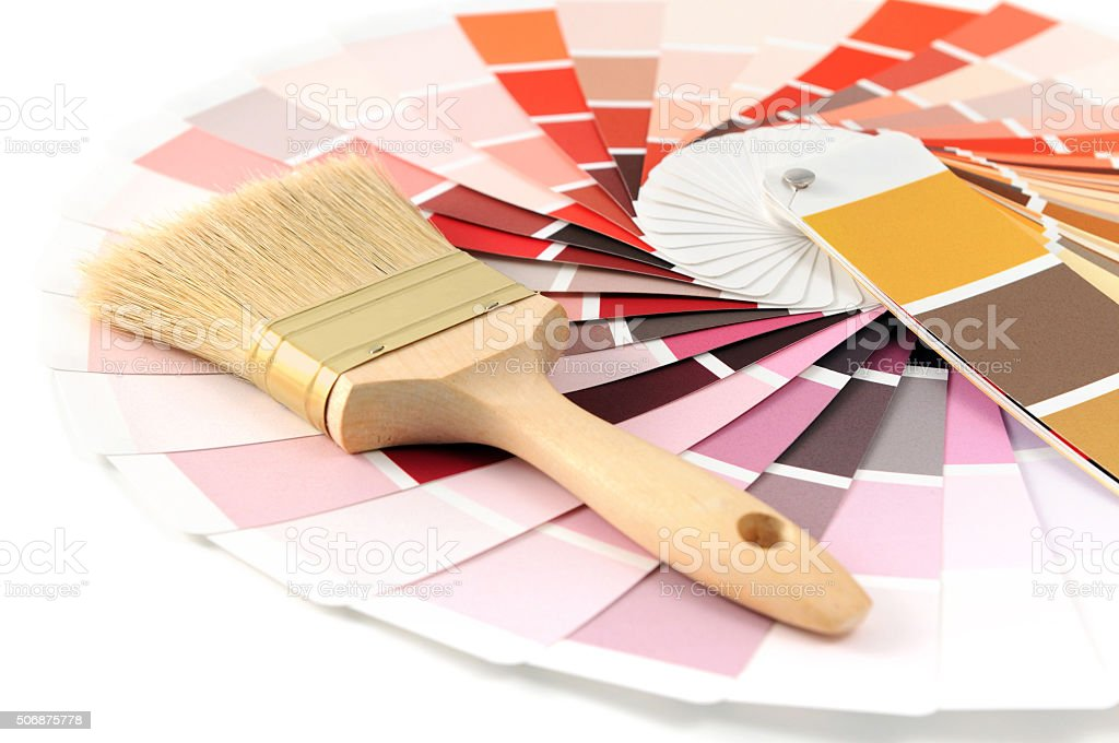 paper color swatches with red color and paintbrush stock photo
