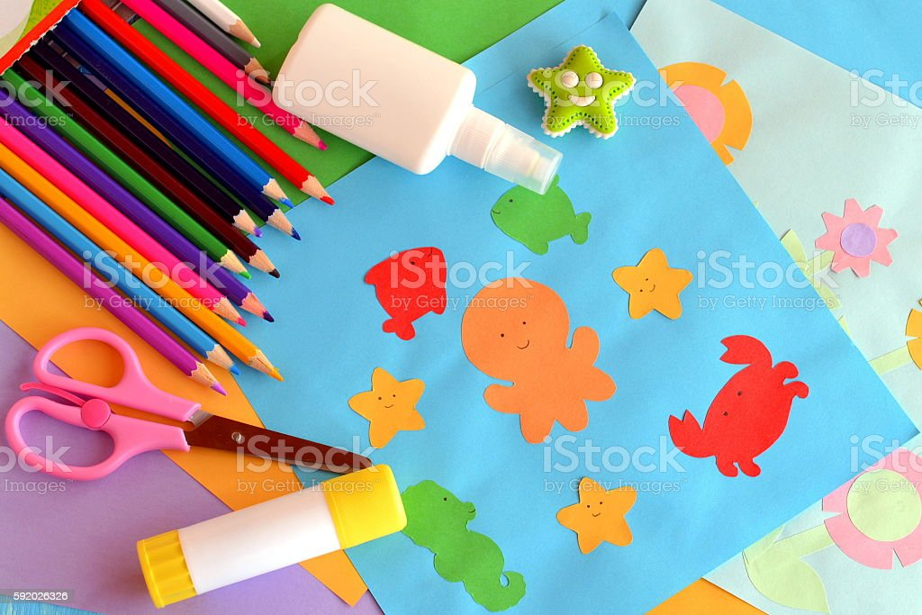Paper colored sea animals and flowers. Children background stock photo