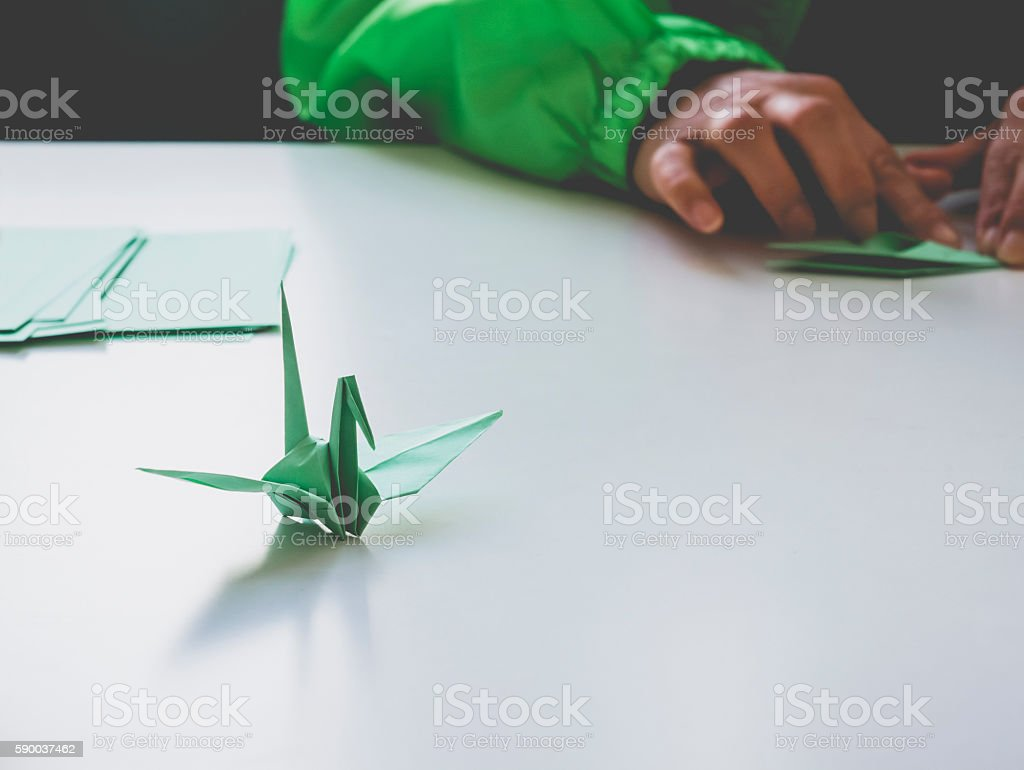 Paper Crane Origami bird with hand fold Art and Craft stock photo