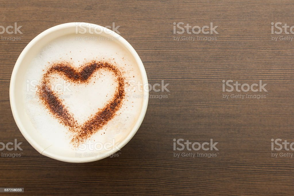 Paper cup of coffee with heart symbol stock photo