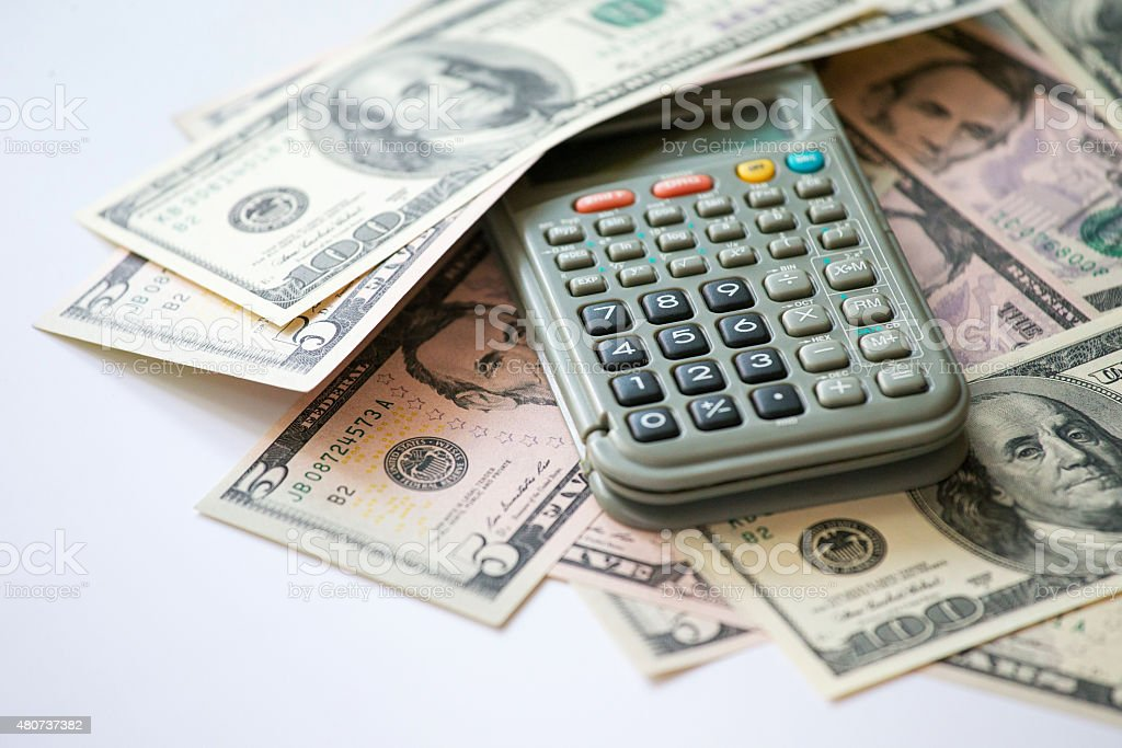 US Paper Currency and calculator stock photo