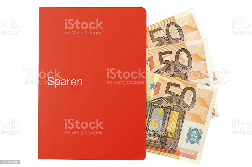paper currency falling in savings bank book stock photo