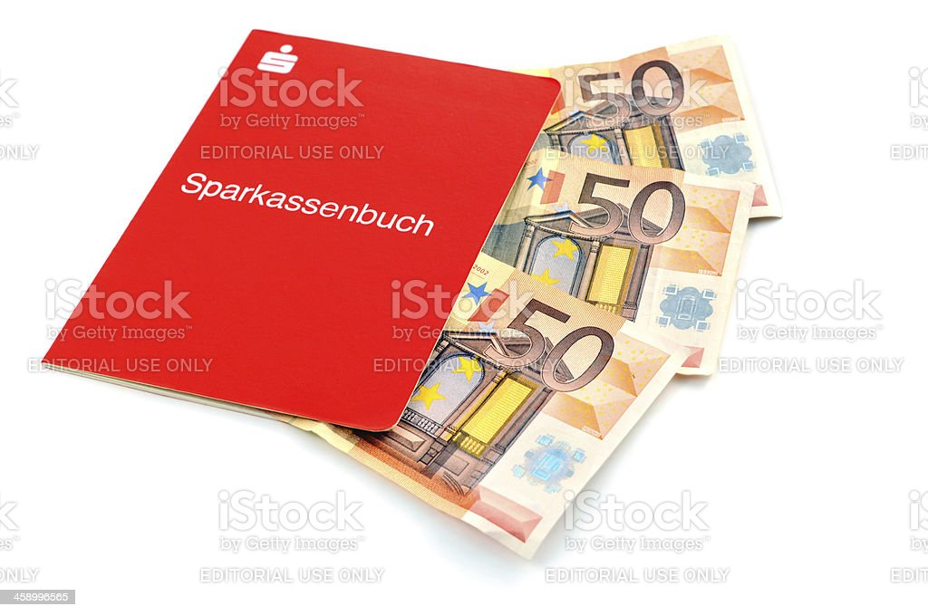 paper currency falling in savings Sparkassenbuch saving bank boo stock photo
