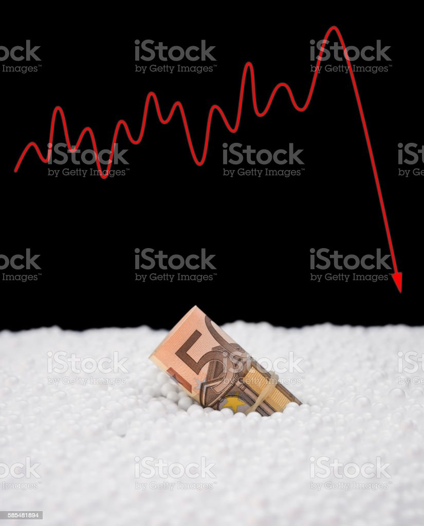 EU paper currency sink into polystyrene particle stock photo