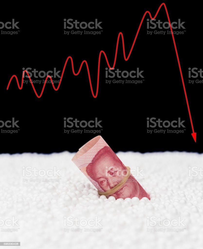 RMB paper currency sink into polystyrene particle stock photo