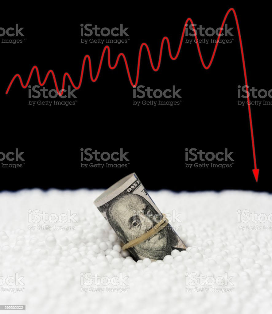 USD paper currency sink into polystyrene particle stock photo