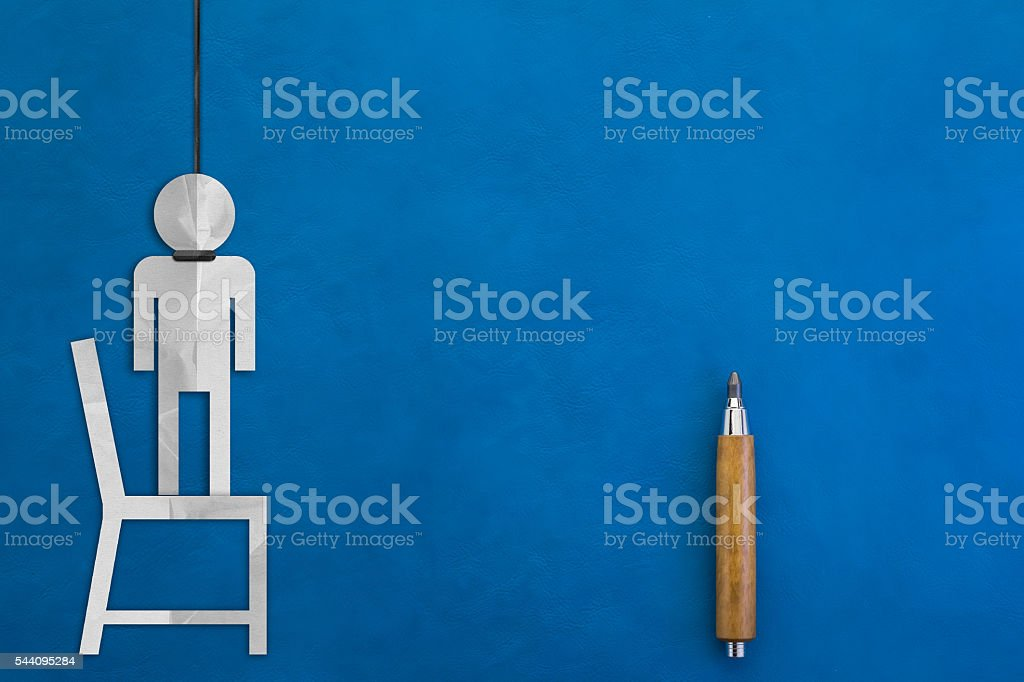 paper cut figure of human hanging with blue background stock photo