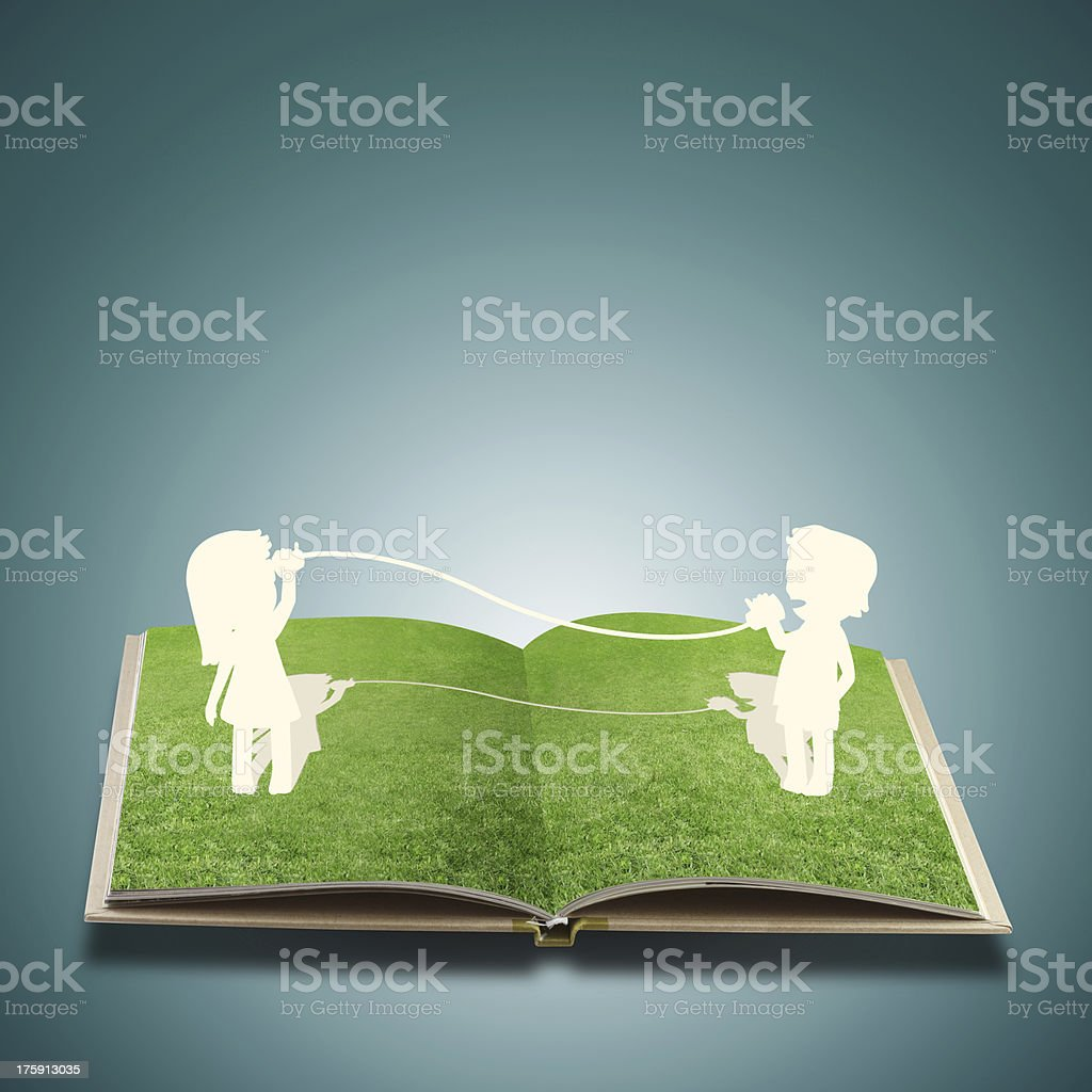 Paper cut of child on grass book royalty-free stock photo