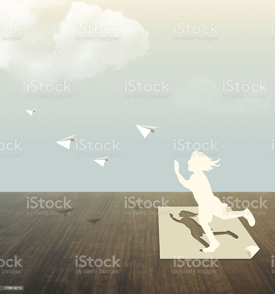 Paper cut of child on wood table with sky royalty-free stock photo