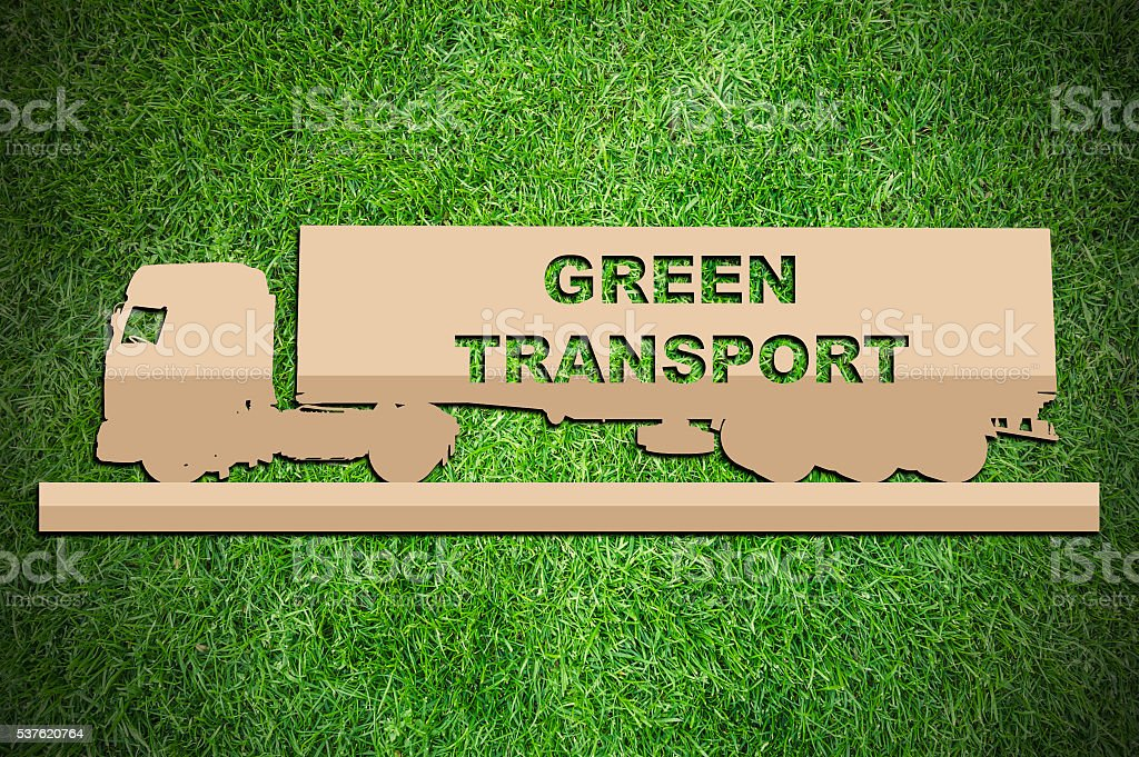 Paper cut of eco on green grass stock photo