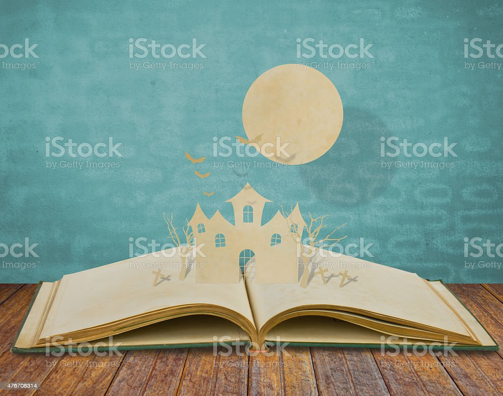 Paper cut of halloween on old book stock photo