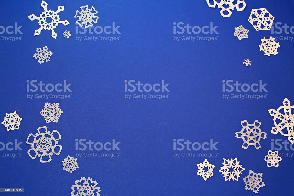 paper cut out snowflakes stock photo